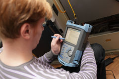 Engineer setting reflectometer Stock Photography