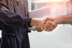 Engineer shaking hand with with colleagues to cooperate and dea. L in business successful stock images