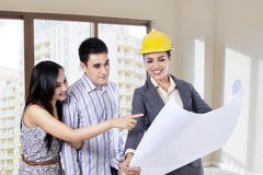 An engineer showing blueprint Royalty Free Stock Images
