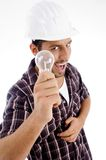 Engineer showing electric bulb Royalty Free Stock Photo