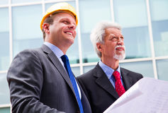 Engineer showing something to his partner Royalty Free Stock Photo