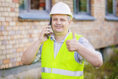 Engineer showing thumb up near the building Stock Image