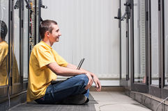 The engineer sits in datacenter Stock Image