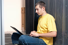 The engineer sits front at equipment Stock Photo