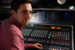 Engineer Sitting At Mixing Desk In Recording Studio Royalty Free Stock Photography