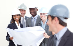 Engineer smiling at his team in the background Stock Photography