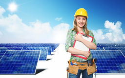 Engineer and solar panel. Smiling engineer and solar panel background Royalty Free Stock Photo