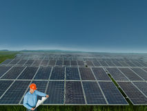 Engineer in solar panel station Stock Photos