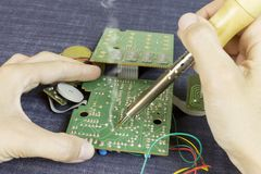 Engineer soldering electronic components royalty free stock photos