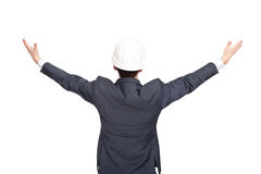 Engineer standing back view holding his arms up. Isolated on white background Stock Photos