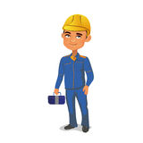 Engineer standing in construction clothing and yellow helmet, keeping tools in the hands. Stock Photo
