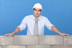 Engineer standing by a wall Royalty Free Stock Image