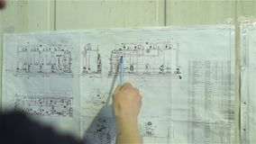 The engineer studies the scheme of the water treatment plant stock video