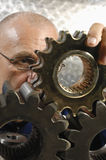 Engineer studying a gear machinery stock image