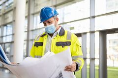 Free Engineer Studying Plan At Construction Site With Protective Face Mask Royalty Free Stock Photo - 213953245