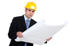 Engineer studying plans Stock Photography