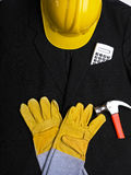 Engineer suit - Hardhat Hammer Gloves Calculator Royalty Free Stock Image