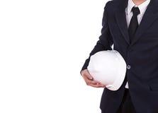 Engineer in suit holding helmet Stock Photos