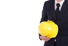 Engineer in suit holding helmet Stock Photography