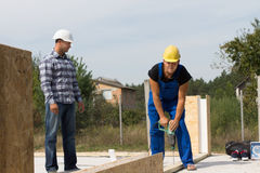 Engineer Supervising Construction Worker at Site Royalty Free Stock Photos