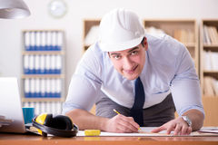 The engineer supervisor working on drawings in the office Royalty Free Stock Image