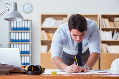 The engineer supervisor working on drawings in the office Royalty Free Stock Photo