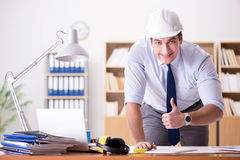 The engineer supervisor working on drawings in the office Royalty Free Stock Images