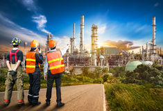 Engineer survey of oil refiner. Engineer team in uniform are safety survey of the oil refiner industry royalty free stock photos