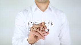 Engineer System, Man Writing on Glass Stock Images