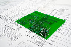 Engineer table design. With schematics and printed circuit board Stock Photo