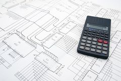 Engineer table with schematics and calculator. Engineer table with electronic schematics and calculator Royalty Free Stock Images