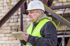 Engineer with tablet PC in factory Stock Images