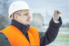 Engineer with tablet PC on the field in winter Stock Images