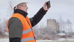 Engineer with tablet PC on the field in winter stock footage