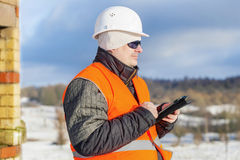 Engineer with tablet PC near building Stock Photo