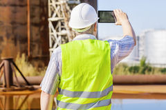 Engineer with tablet PC near to the tanks Royalty Free Stock Photography