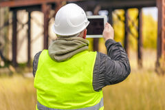 Engineer with tablet PC at outdoors Stock Photo