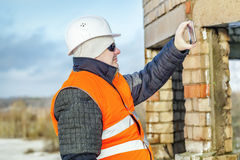 Engineer with tablet PC take a picture near unfinished building Stock Photo