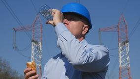 Engineer Take Breakfast at Work Eat a Snack and Drink fresh Water.  stock images