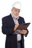 Engineer taking notes. A over white background Royalty Free Stock Photo