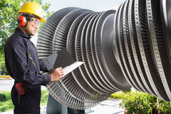 Engineer taking notes for maintenance steam turbine of powerhouse Royalty Free Stock Photography