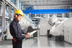 Engineer taking notes for maintenance work  in thermal powerhouse Royalty Free Stock Photography