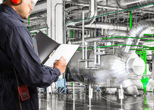 Engineer taking notes at thermal power plant factory Royalty Free Stock Photos