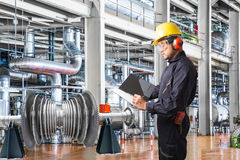 Engineer taking notes at thermal power plant factory.  stock photography