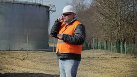Engineer talking on cell phone in factory stock footage