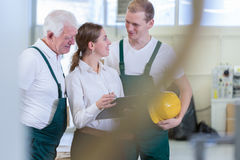 Engineer talking with plant workers Stock Image