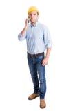 Engineer talking on smartphone isolated on white background Stock Image