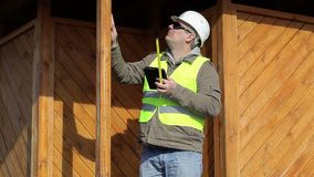Engineer with a tape measure and tablet PC stock video