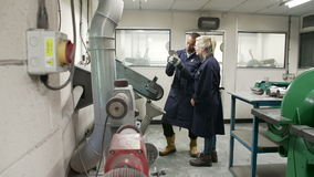 Engineer Teaching Apprentice To Use Grinding Machine Royalty Free Stock Images