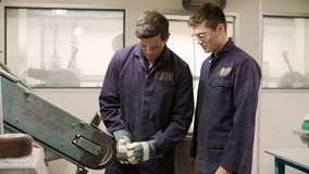Engineer Teaching Apprentice To Use Grinding Machine Royalty Free Stock Image